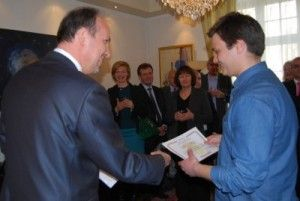 """Romanian Ambassador Daniel Ionita delivering one of five diplomas to Horia Cernusca at the embassy on Monday, part of an effort to showcase """"Young and Successful Romanians in Norway."""" PHOTO: newsinenglish.no"""